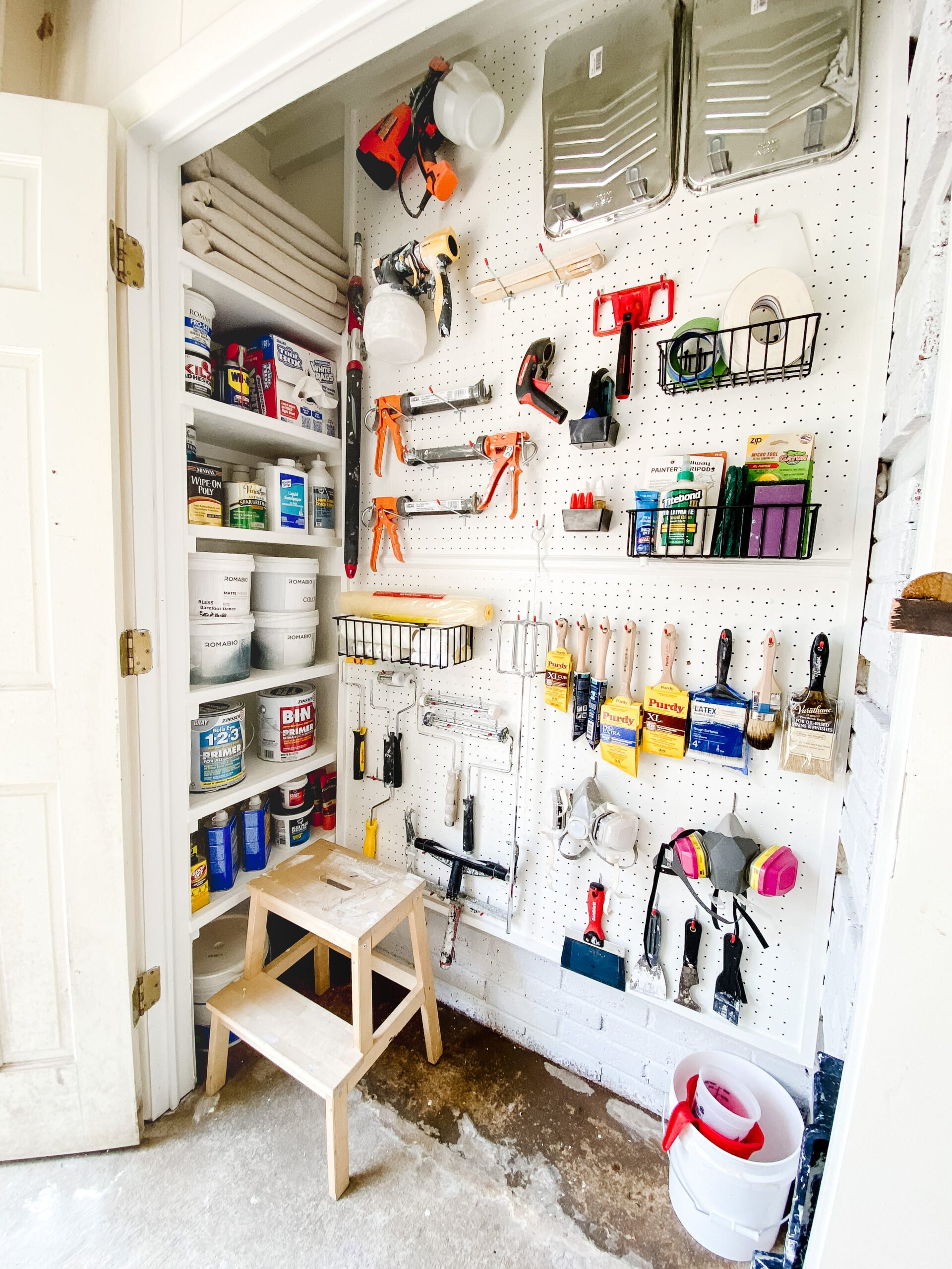 organized paint storage closet