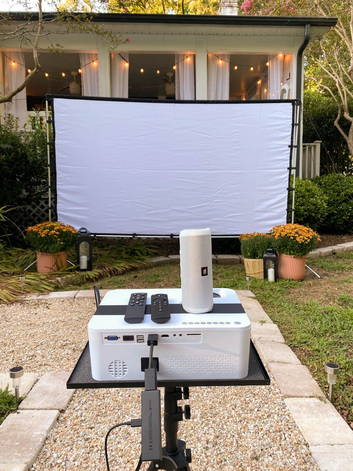 How to set up a backyard movie night with recommended projector, outdoor projector screen, movie streaming device, and bluetooth speaker
