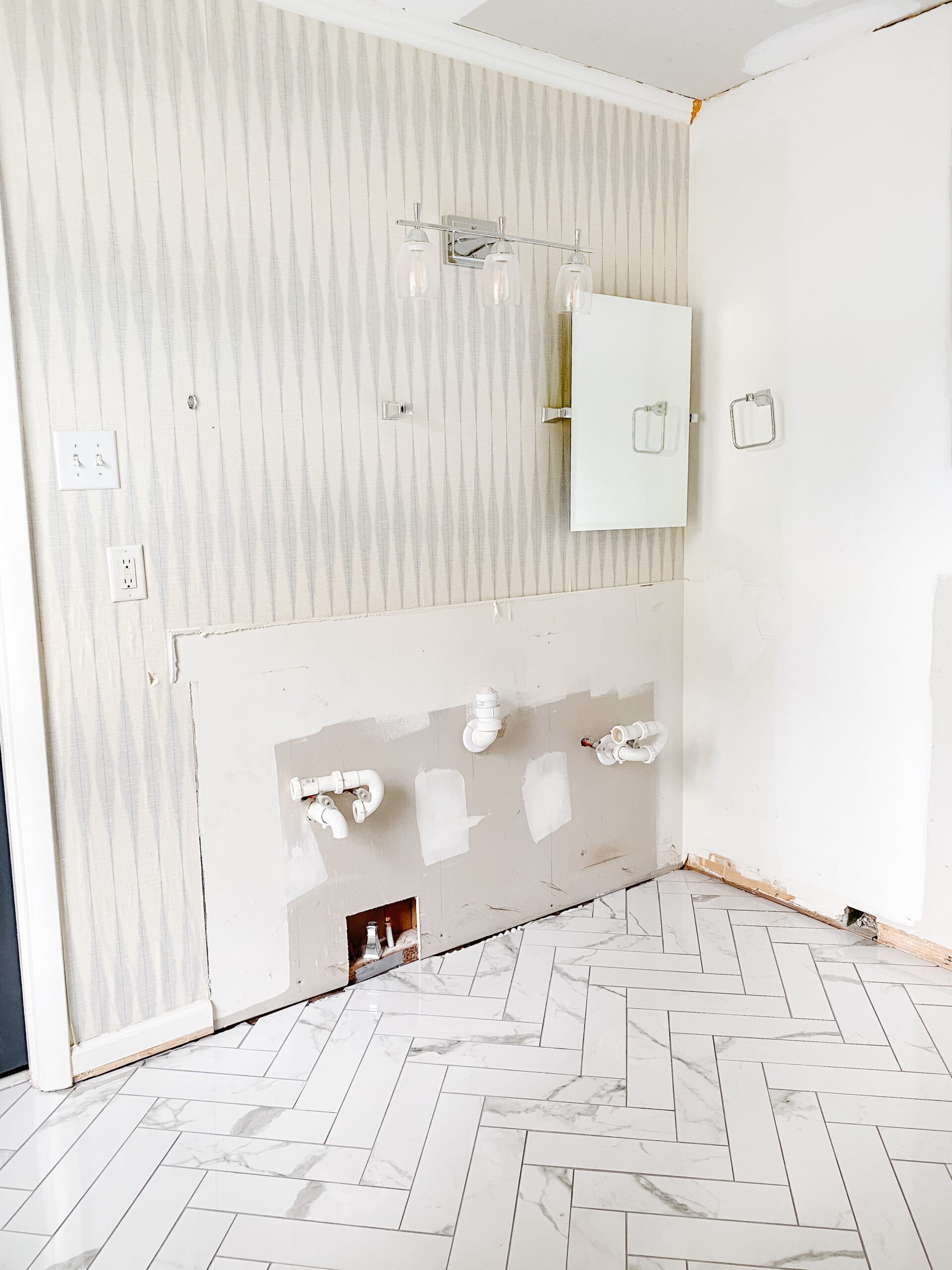 faux marble herringbone tile floor in a bathroom renovation