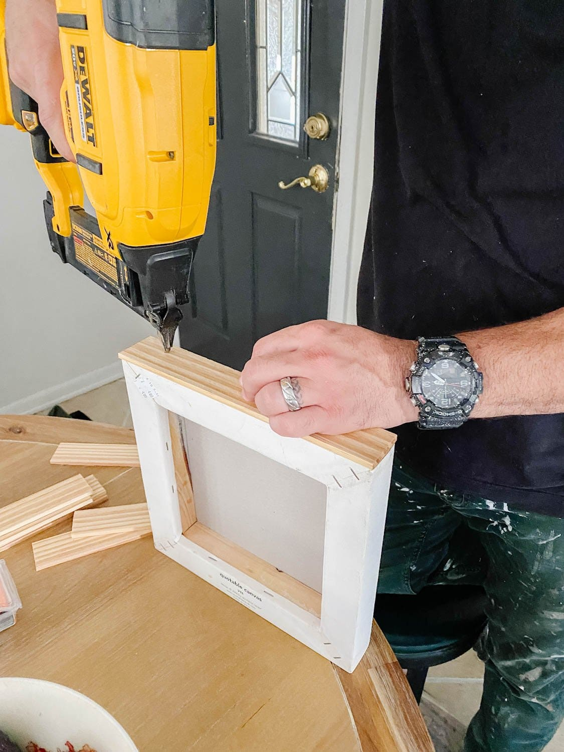 nailing lattice strips to a canvas for a DIY frame
