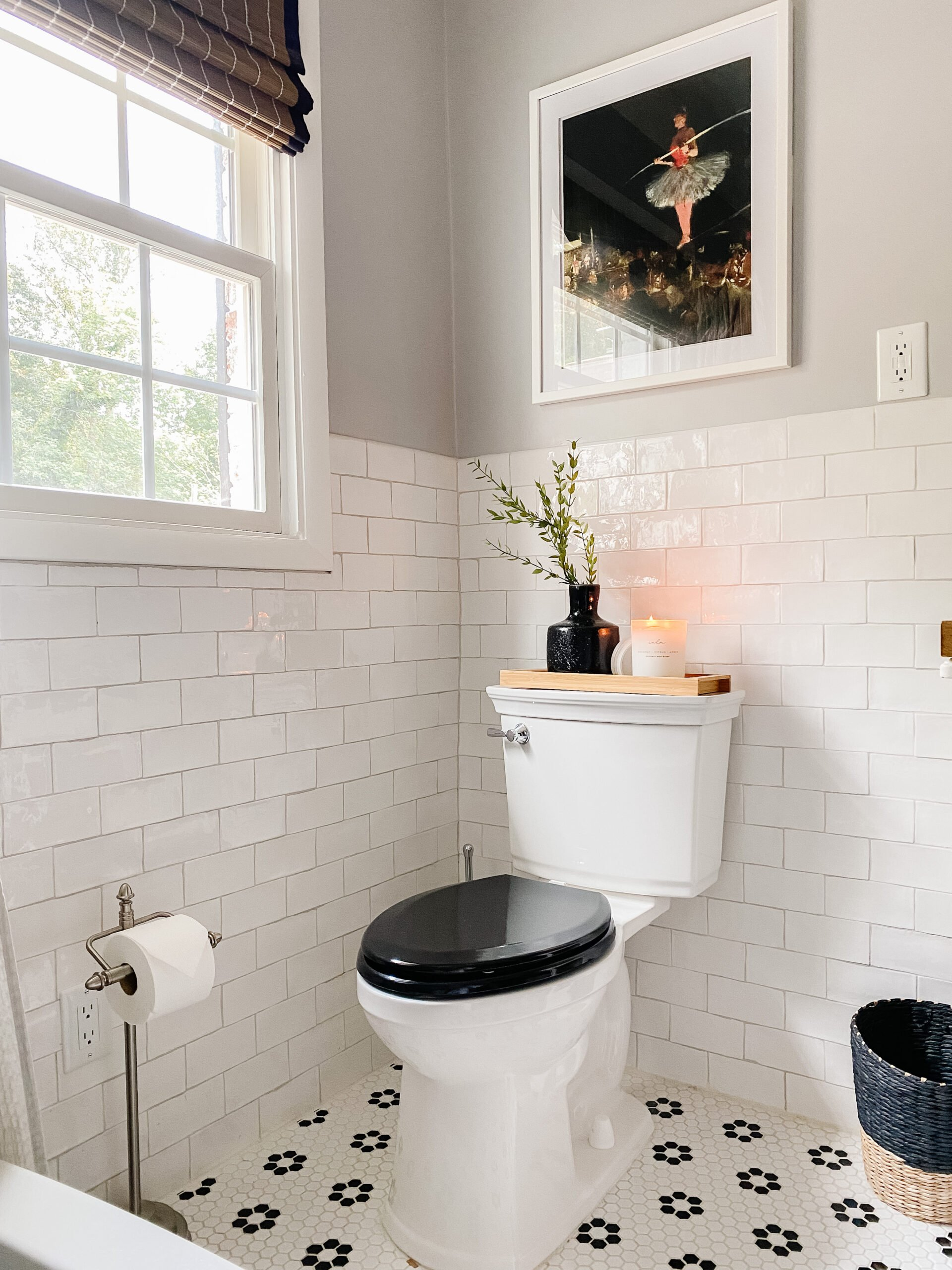retro bathroom with black and white tile and black toilet seat