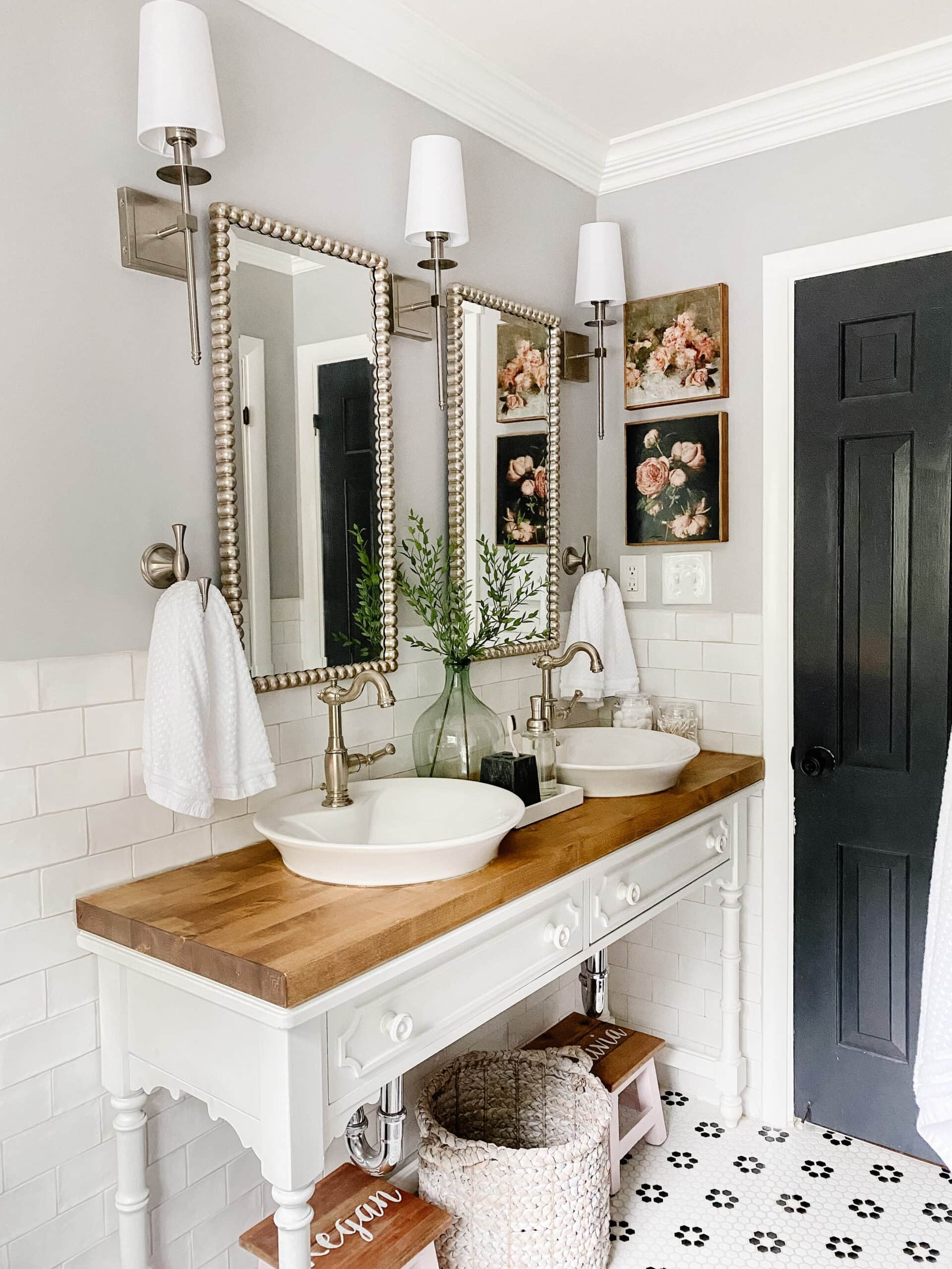 black and white bathroom decor with console table vanity