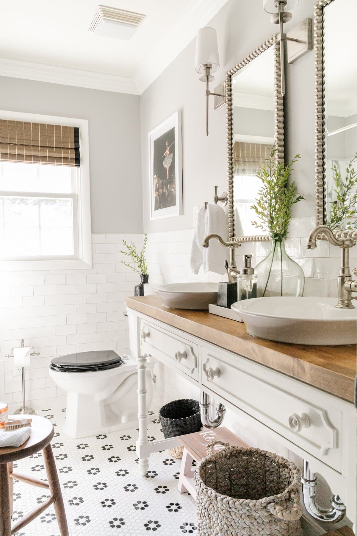 classic black and white bathroom decor with retro tile and Chippendale bamboo style vanity