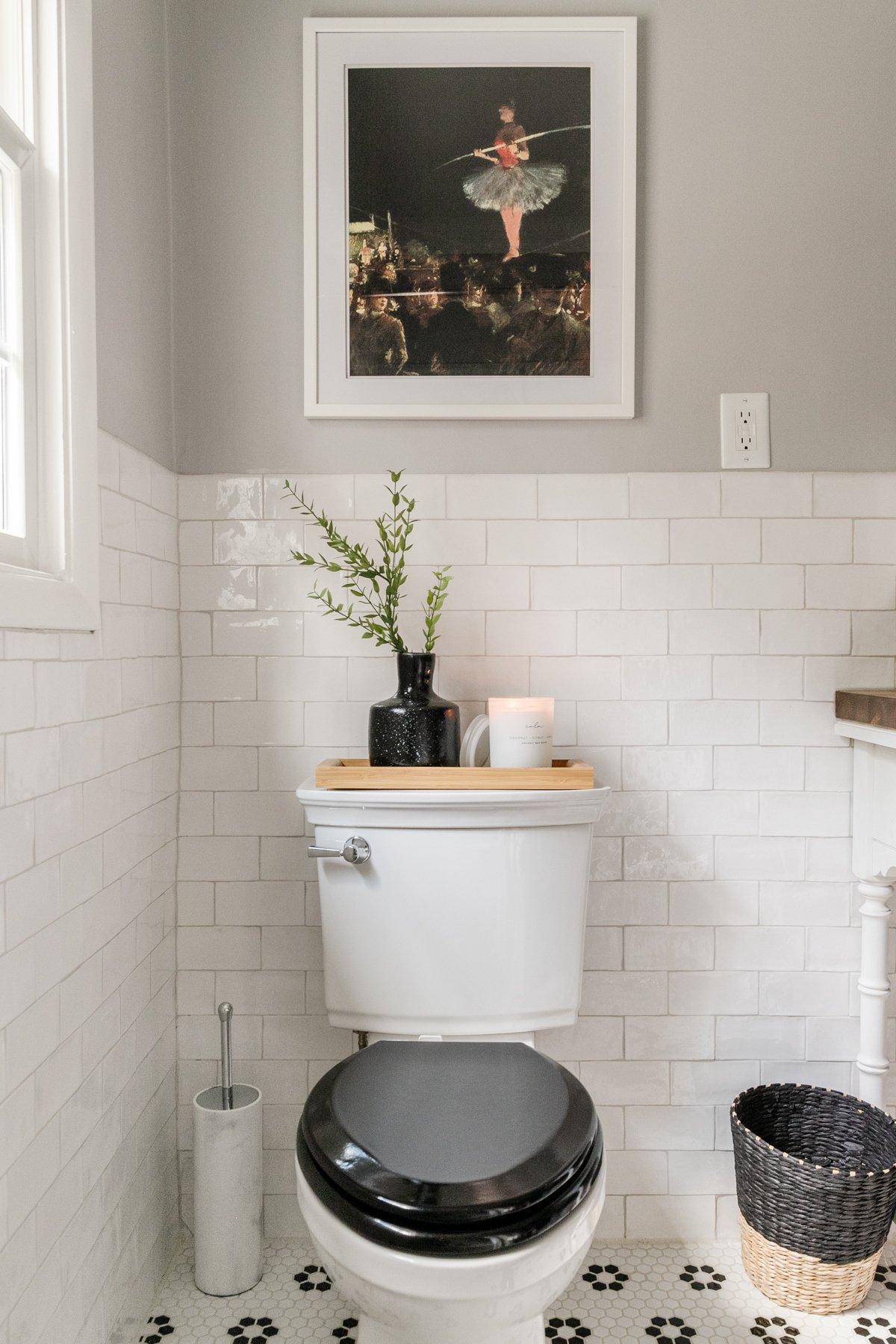 black toilet seat with classic bathroom decor