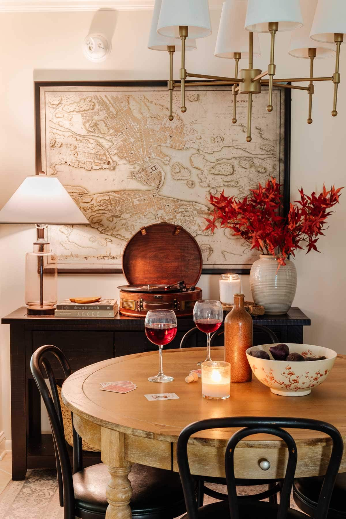 cozy dining room in lamp light with fall decor