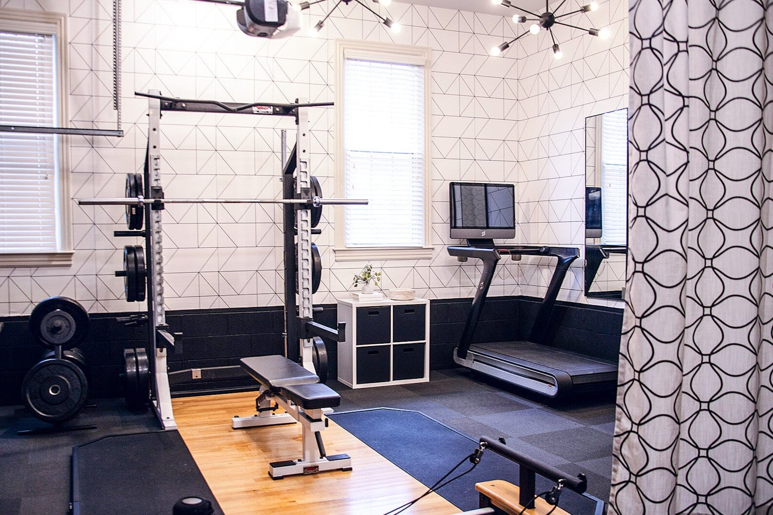 workout room in a garage with curtain divider