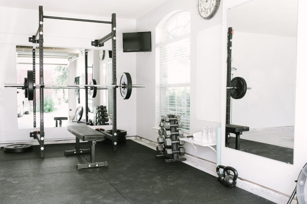 home gym with padded floor and weights