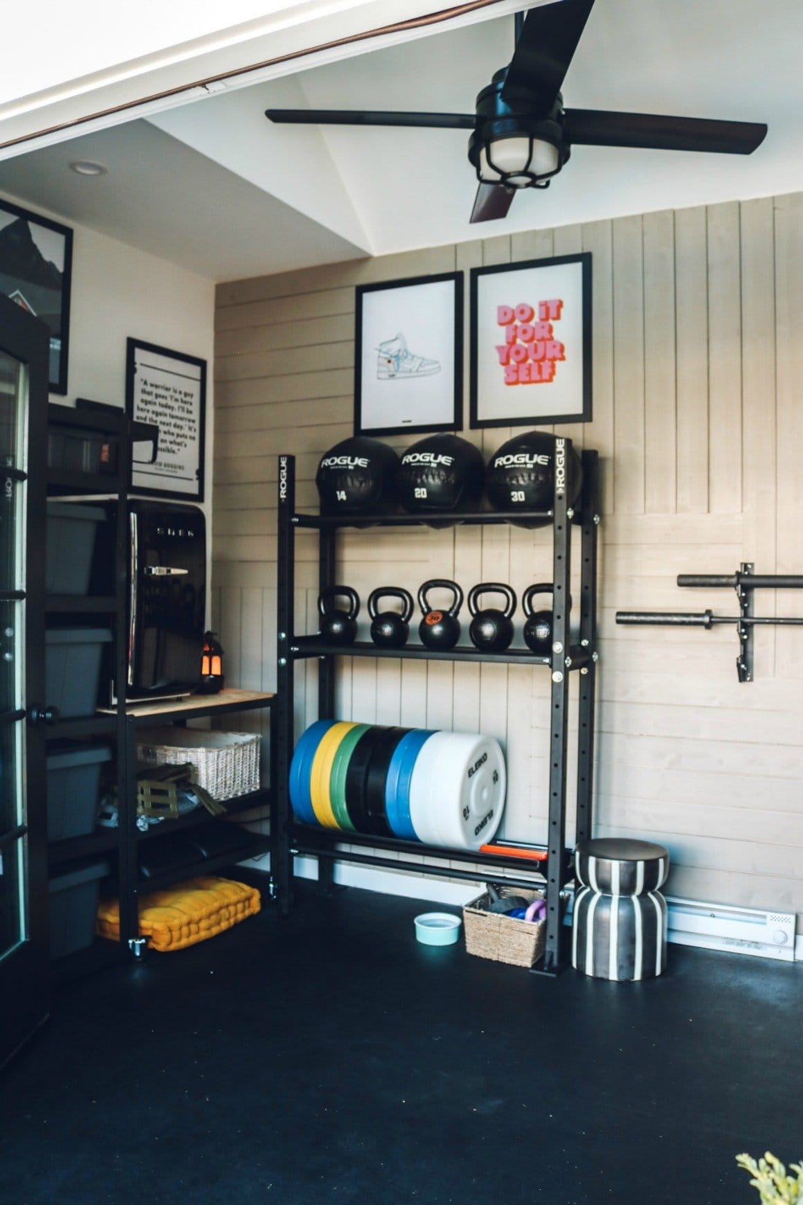 home gym with wall quotes and industrial shelving