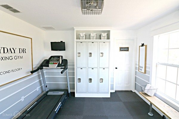 home gym with repurposed lockers and treadmill