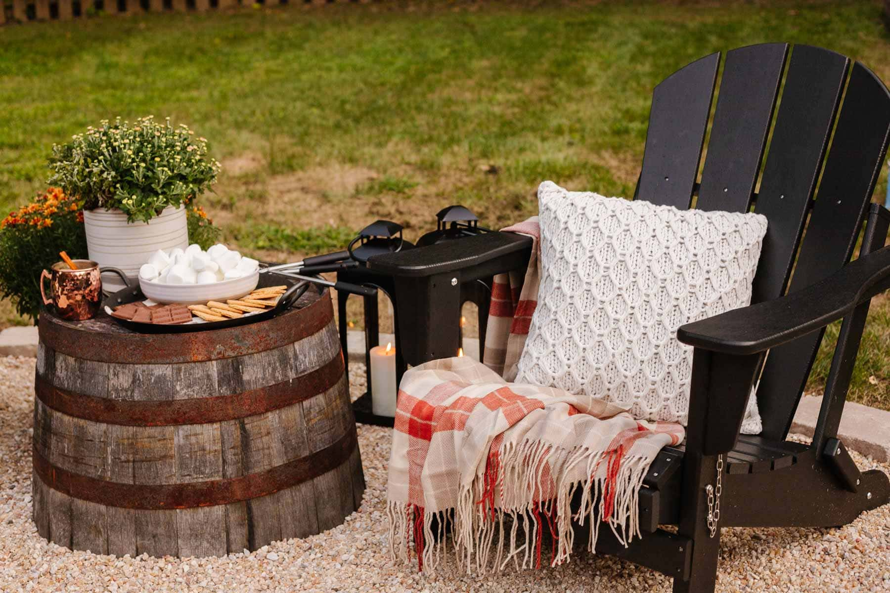 upside down barrel planter used for an outdoor table