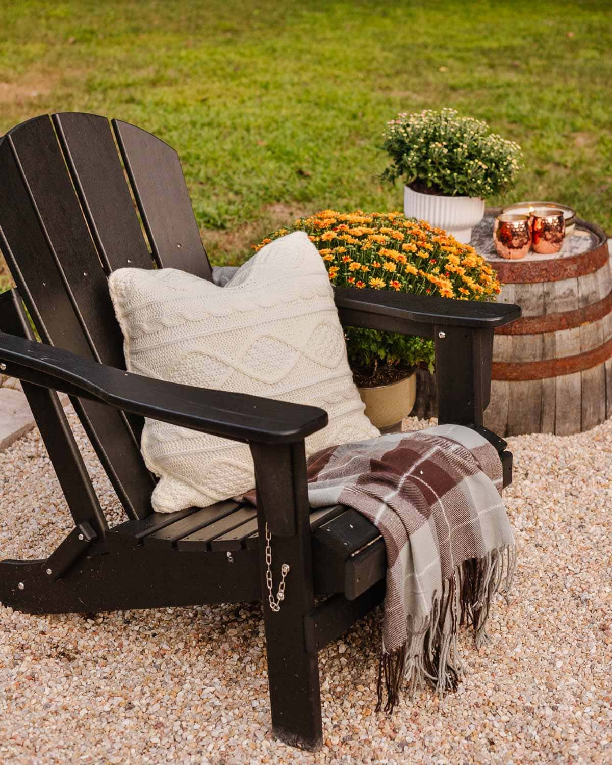 outdoor fall decor - cable knit pillows with plaid blankets