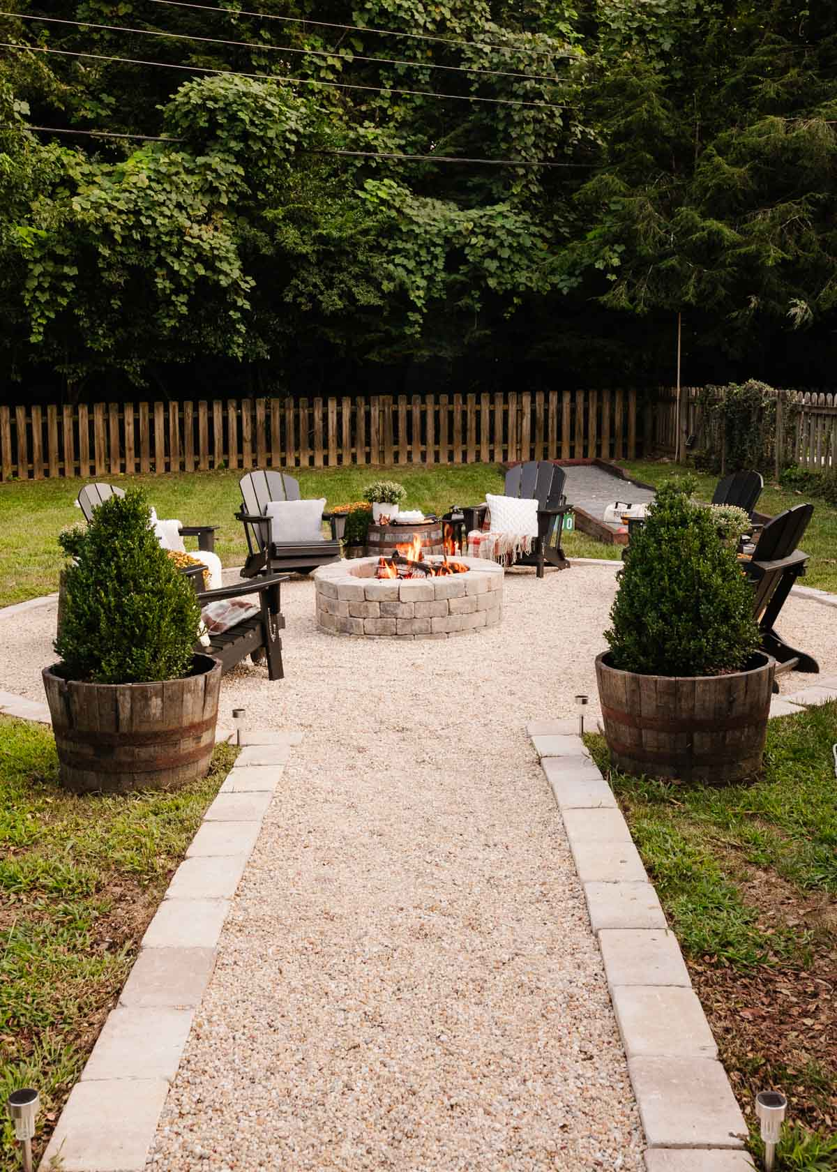 backyard fire pit decorated for fall