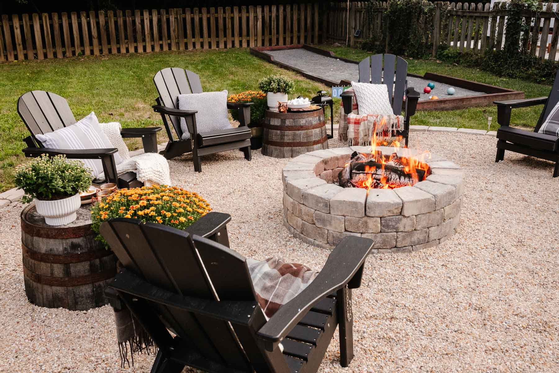 backyard fire pit with fall decor for a backyard party
