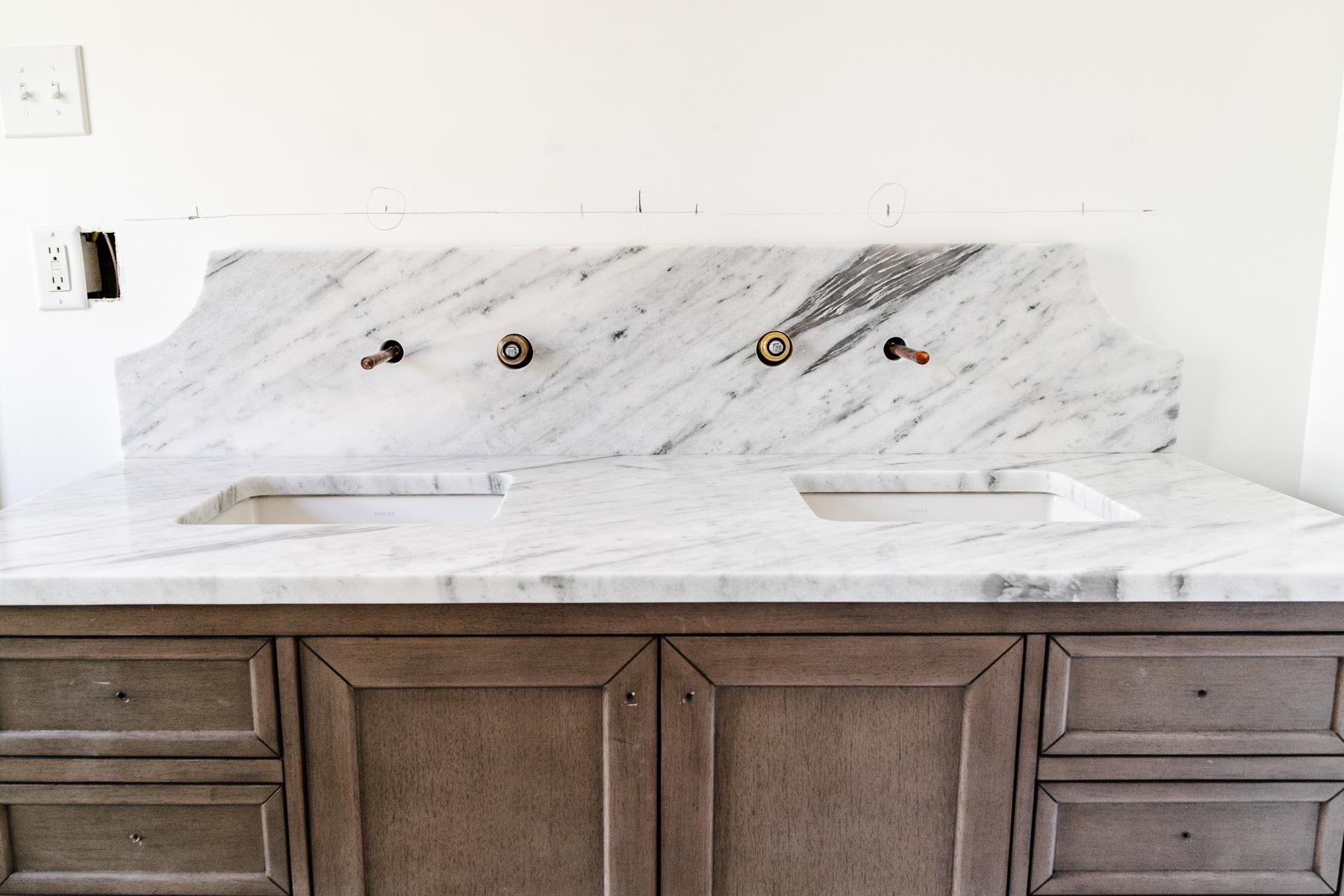 marble countertop and scalloped backsplash