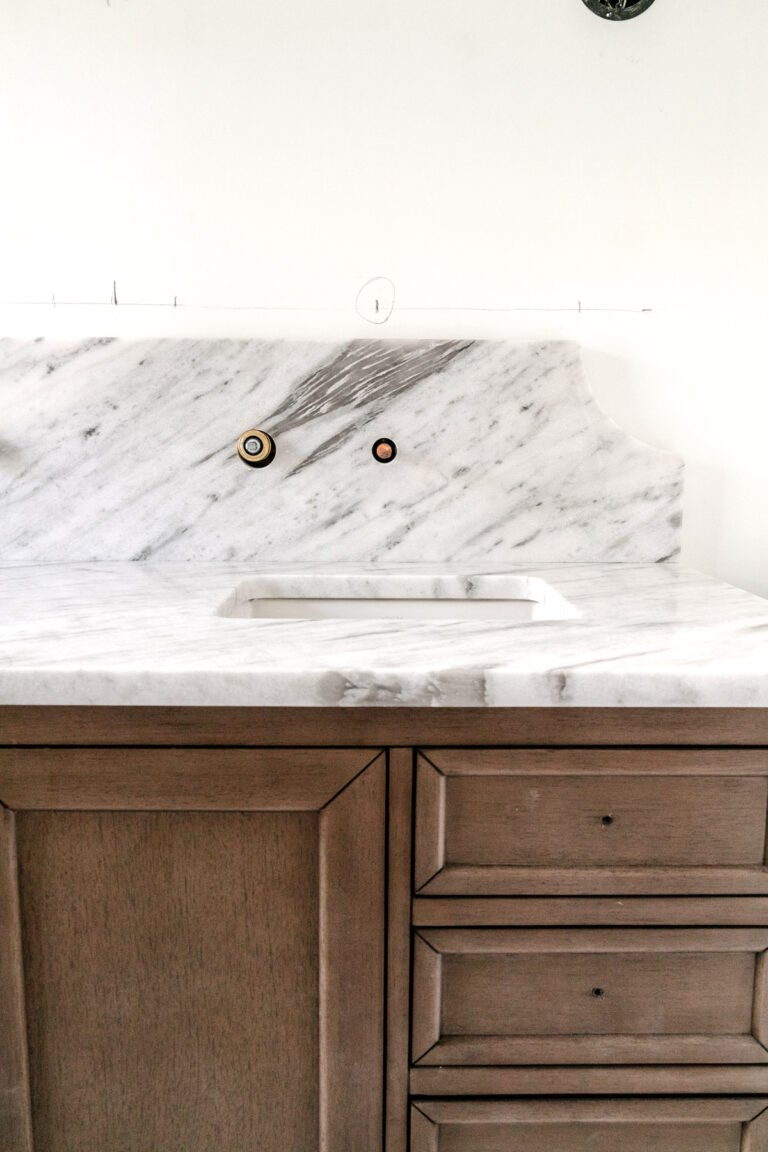 Our Scalloped Marble Backsplash in the Bathroom Reno