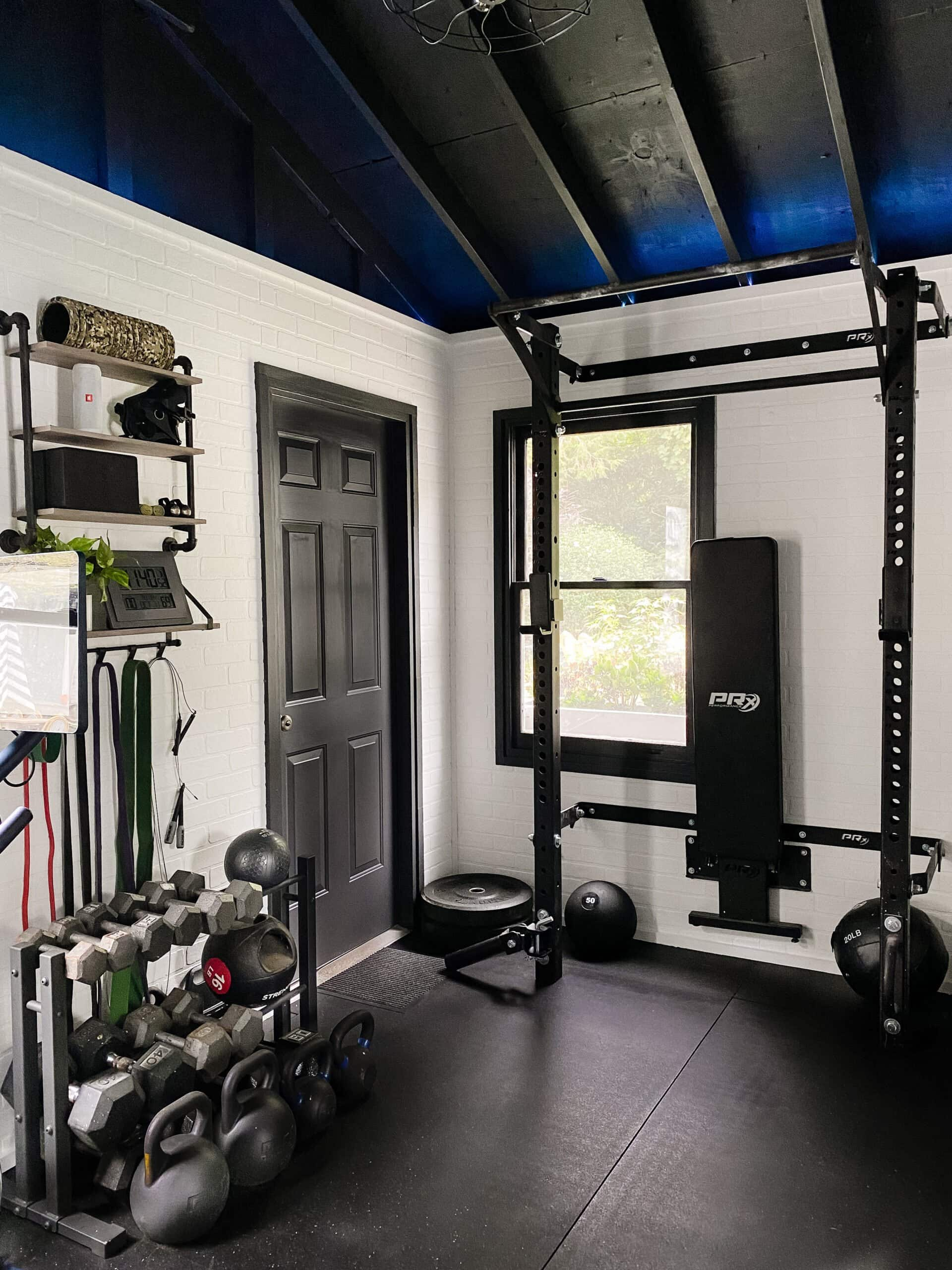 home gym with led lights and weight lifting area