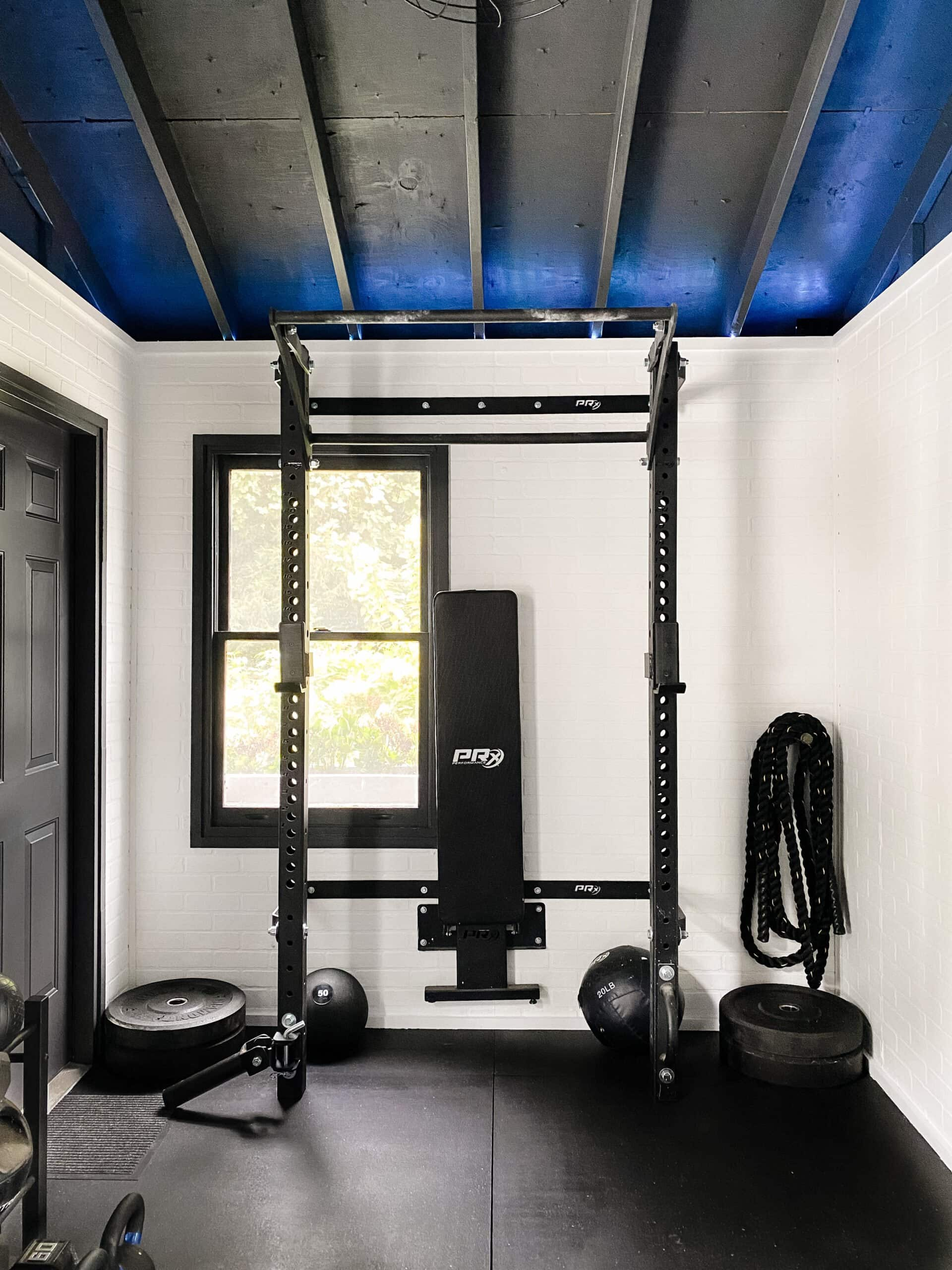 workout shed with squat rack and weight lifting bench