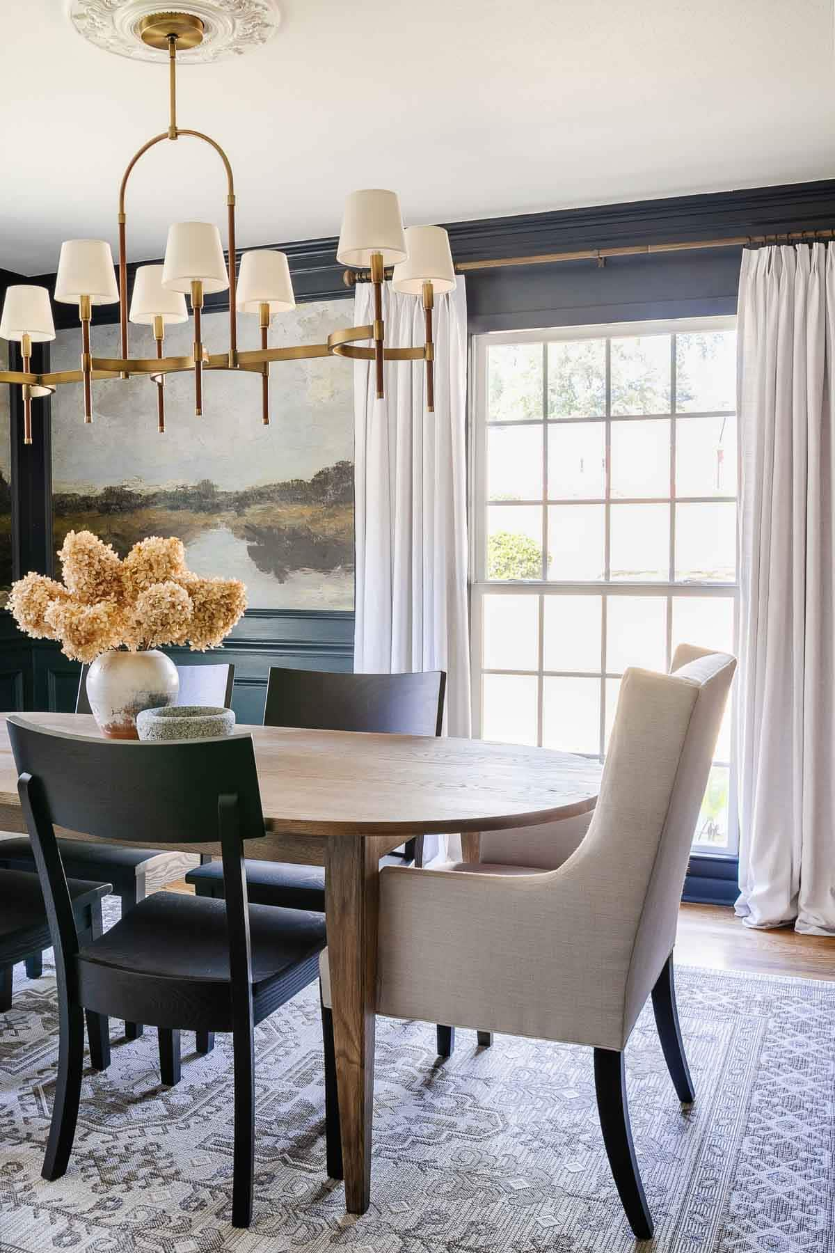 navy blue dining room with scenic peel and stick mural wallpaper
