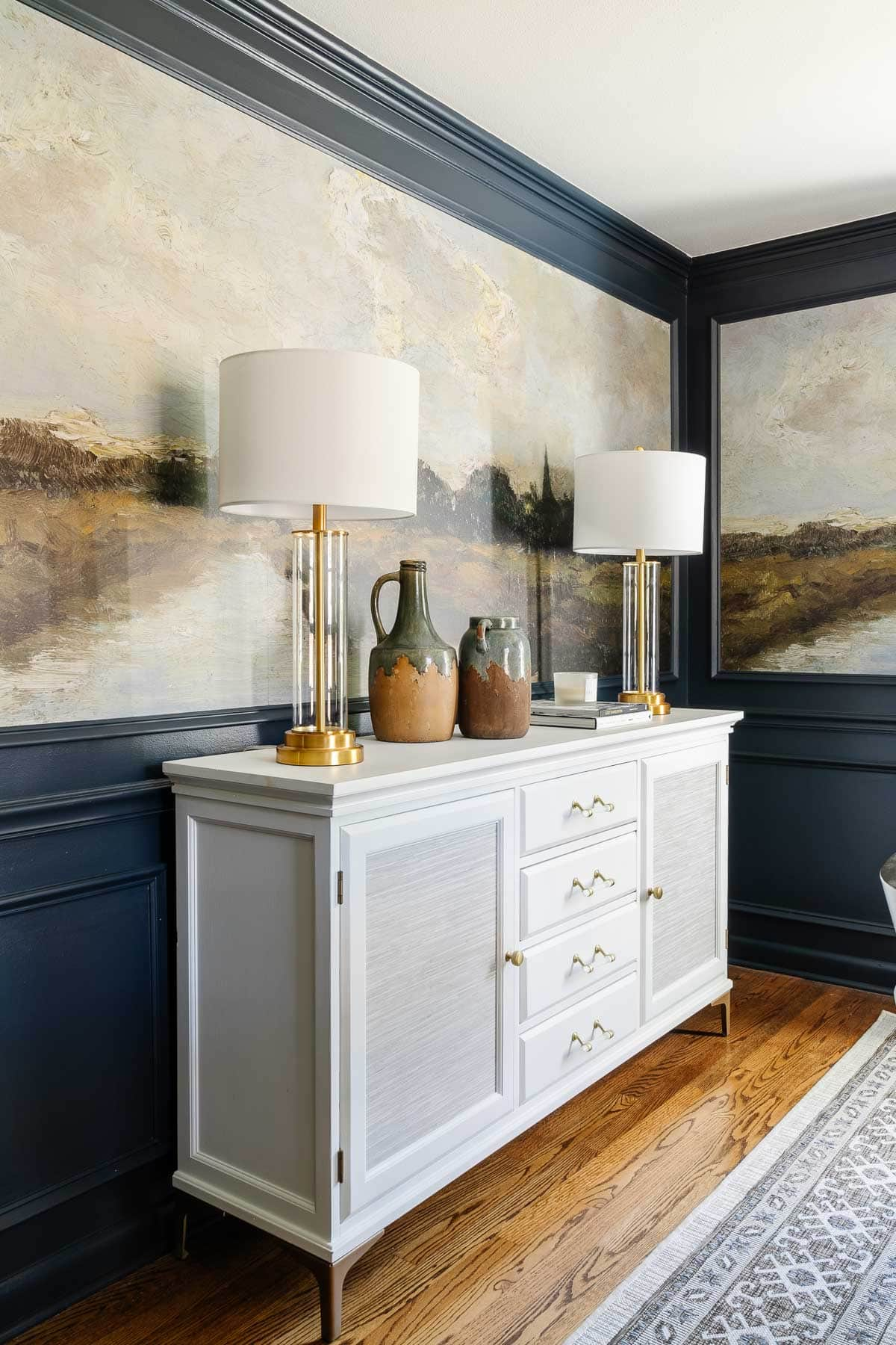 white buffet table with scenic murals