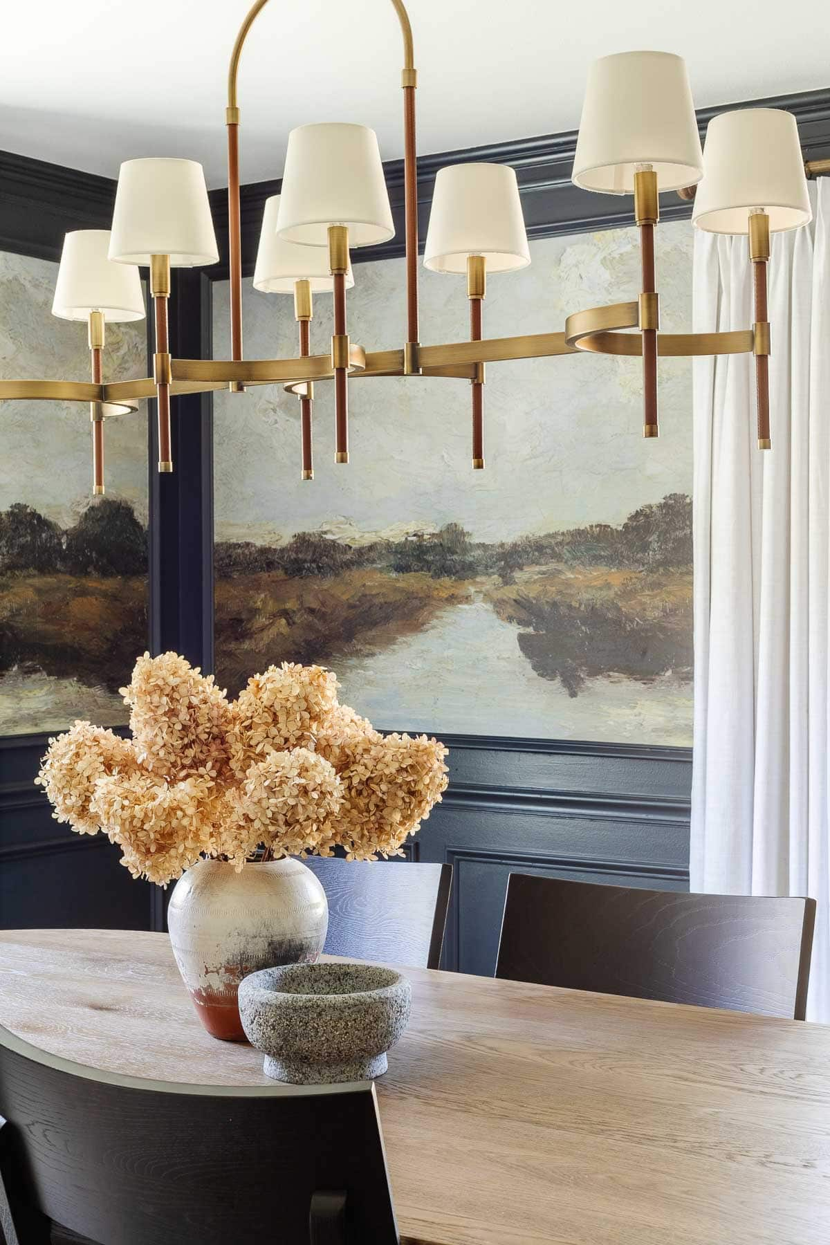 shaded chandelier and dining room murals